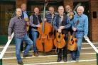Songs and stories for charity: Steve Cassidy, right, with fellow York musicians John Lewis, left, Ken Sanderson, Geoff Earp, Graham Metcalf, Billy Leonard and  Graham Hodge outside the Joseph Rowntree Theatre, York