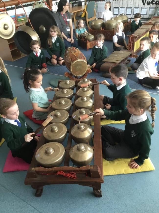 Pupils at Malton Primary School learn how to play Gamelan, the traditional music of Bali and Java