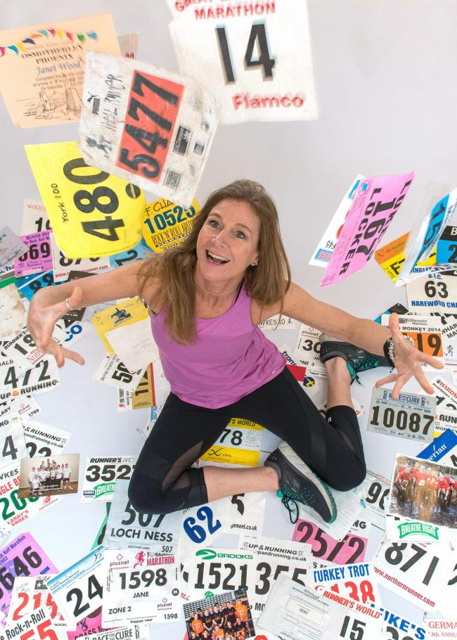 ON THE RUN: Janet Wood, York Pilates expert and running coach, surrounded by memorable race numbers, who is about to run her 54th Marathon in Edinburgh at the age of 54