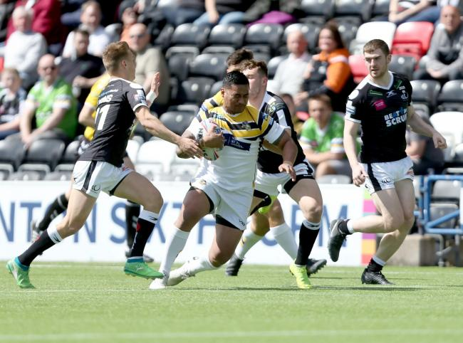 Junior Vaivai takes on the Widnes Vikings defence during a match-winning debut for York City Knights in their Championship clash at the Halton Stadium. Picture: Gordon Clayton