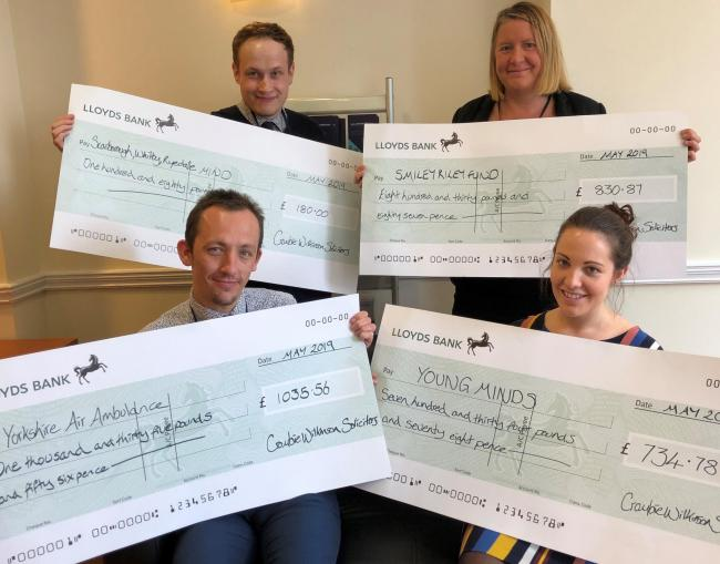 SUPPORT: staff from Crombie Wilkinson Solicitor's handed over cheques totalling more than £2,500 and have vowed to continue their fundraising efforts over the coming year