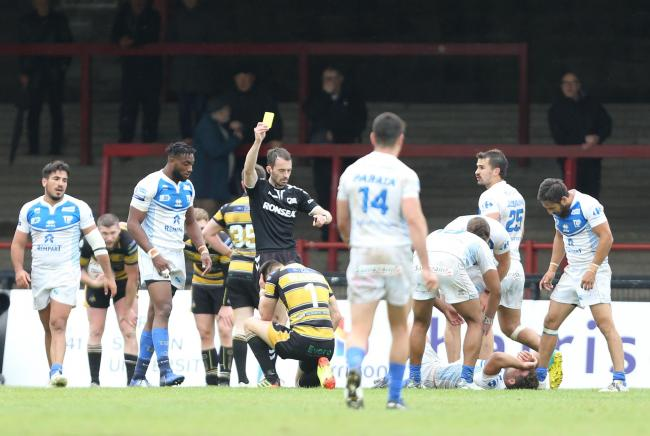 Referee James Child hands out a late yellow card to York City Knights full-back Matty Marsh (grounded), with Toulouse Olympique going on to seal their Betfred Championship victory at Bootham Crescent. Picture: Gordon Clayton