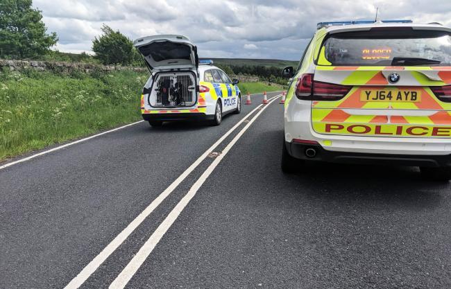 Police officers at the scene of the crash on the B1257 at Chop Gate. Picture: Mark Patterson / North Yorkshire Road Policing Group