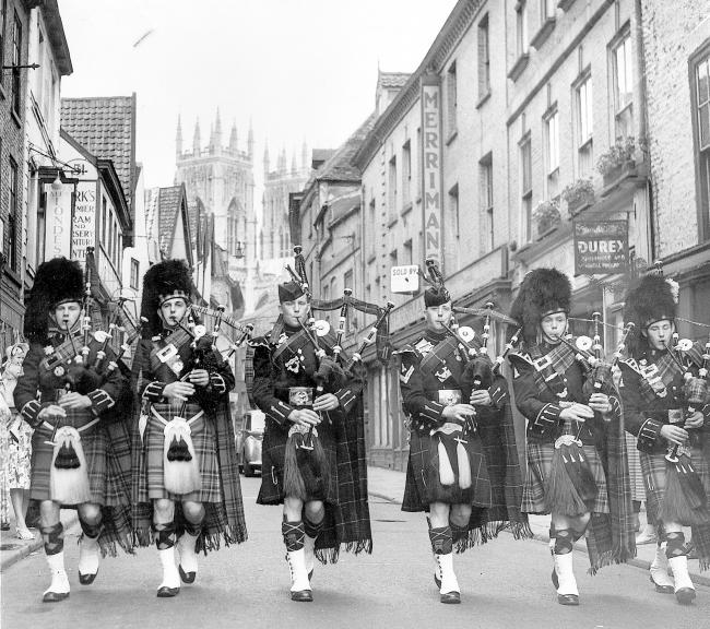 Pipers from the Royal Scots Greys Black Watch in York in 1955 for a military tattoo